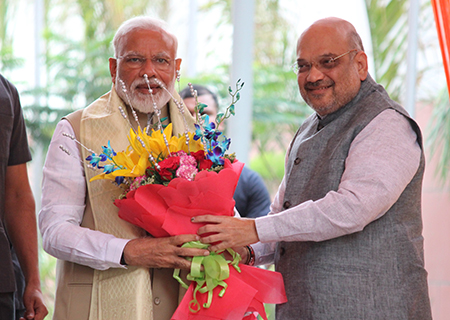 New Delhi: Prime Minister Narendra Modi being welcomed by BJP chief Amit Shah on his arrival at the party's headquarters in New Delhi on May 21, 2019. (Photo: Amlan Paliwal/IANS)