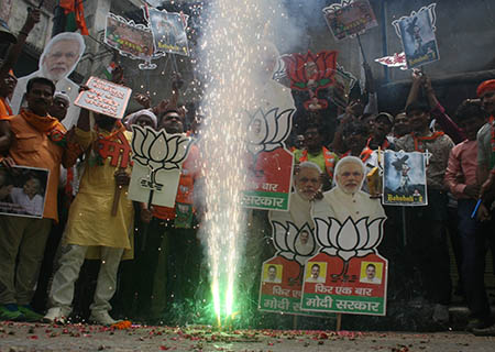 Bikaner: BJP workers celebrate the party's performance with 'gulaal' and sweets after most exit polls showed the BJP-led NDA getting a comfortable majority in the recently concluded 2019 Lok Sabha elections, in Bikaner on May 20, 2019. (Photo: IANS)