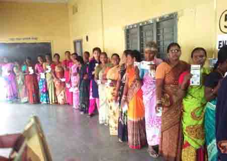 Hyderabad: Voters queue up at a polling station to cast their votes for Telangana municipal elections, in Hyderabad on Jan 22, 2020. The polling began at 7 a.m. in 120 municipalities and nine municipal corporations across the state and it will continue till 5 p.m. (Photo: IANS)